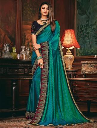 Rama green colored satin silk saree