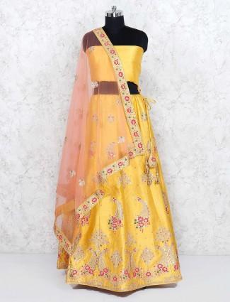 Raw silk fabric semi stitched yellow hue lehenga choli