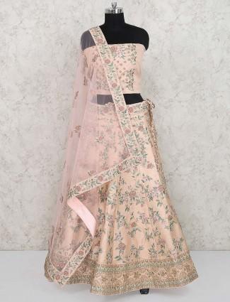Raw silk peach hued bridal wear semi stitched lehenga choli