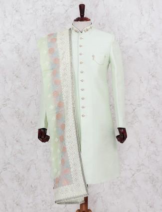 Raw silk solid pista green wedding indo western