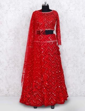 Red colored party wear net fabric lehenga choli
