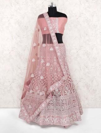Rose pink pretty semi stitched net lehenga choli