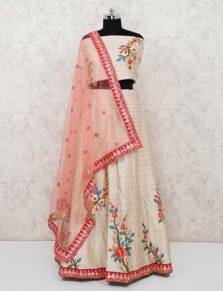Semi stitched bhagalpuri silk lehenga in beige color