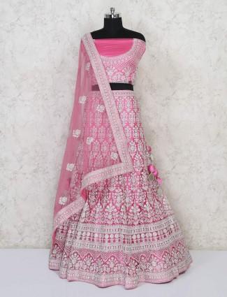 Semi stitched pink net lehenga for wedding bride