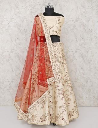 Silk fabric cream hue bridal semi stitched lehenga choli