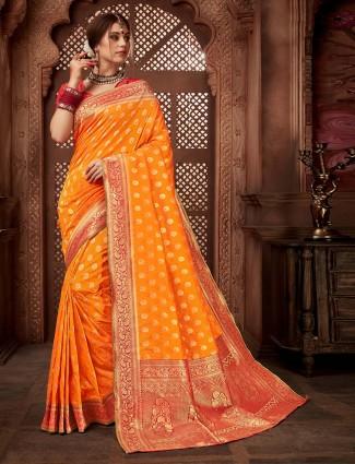 Silk fabric orange hue wedding saree