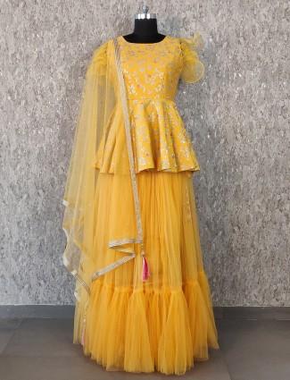 Silk fabric yellow hue party wear lehenga choli