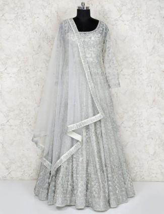 Silver hue net floor length gown