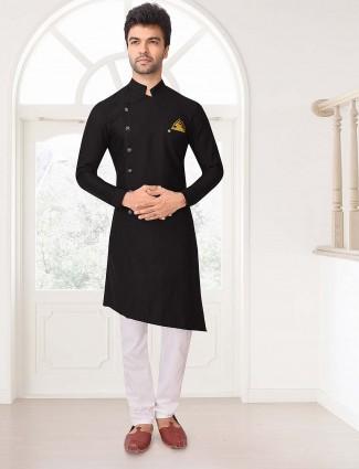 Simple black hue solid stand collar kurta suit