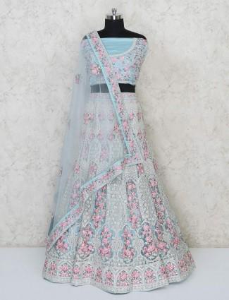 Sky blue designer semi stitched wedding lehenga in net