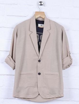 Solid beige hued cotton blazer