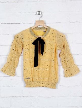 Twisty light yellow dot print cotton top