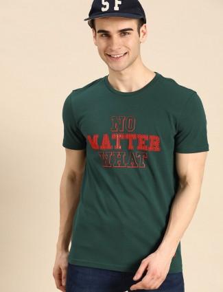 UCB green emboss printed casual wear t-shirt