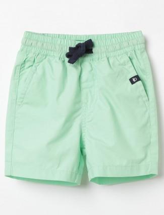 UCB solid green cotton short