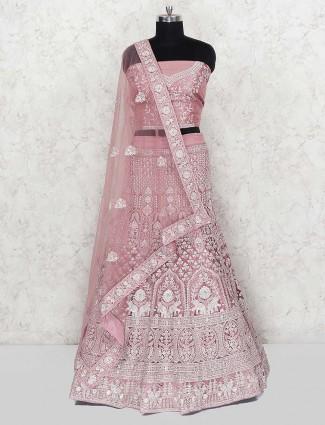 Violet hue wedding wear semi stitched net lehenga choli