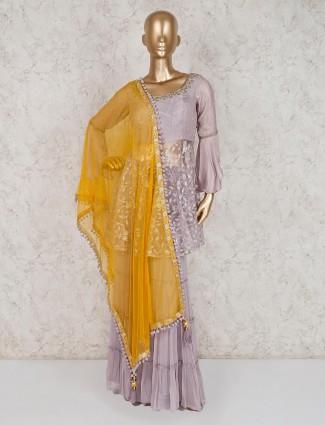 Violet net party wear punjabi sharara suit