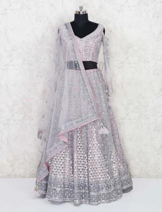 Wedding function pink net lehenga choli