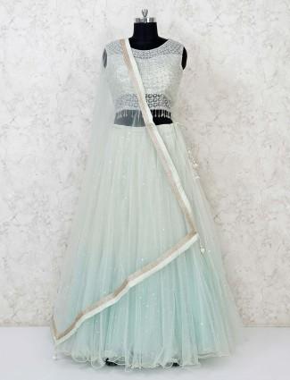 Wedding function pista green net lehenga choli