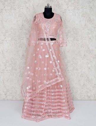 Wedding wear peach net lehenga choli