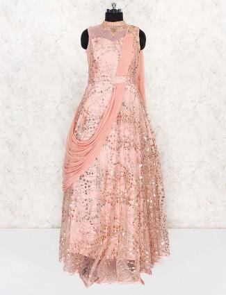 Wedding wear pink hued net fabric gown