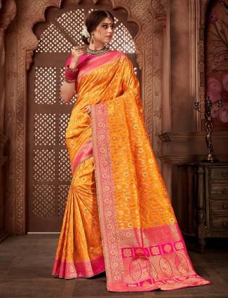 Wedding wear yellow color silk saree
