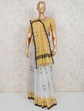 White and yellow linen checks saree