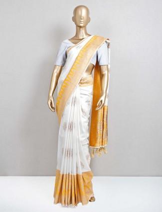 White and yellow semi silk saree for festive occasion