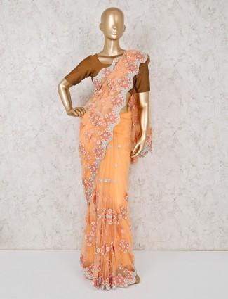 Wonderful peach net saree