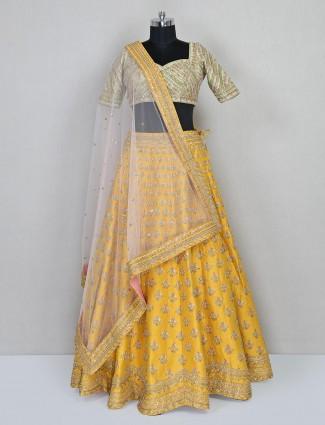 Yellow and green bridal lehenga choli in silk