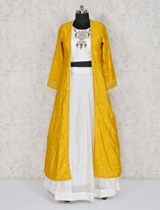 Yellow and white jacket style lehenga suit