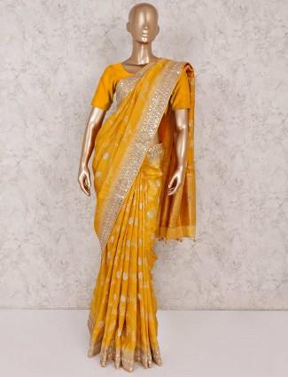 Yellow banarasi silk wedding wear saree