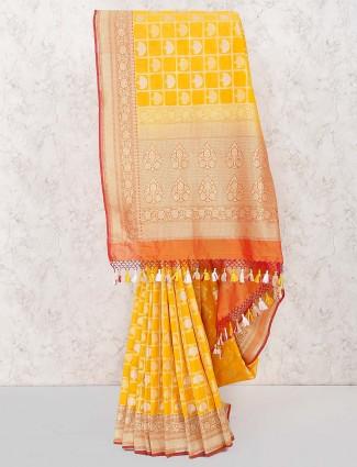 Yellow color banarasi semi silk saree