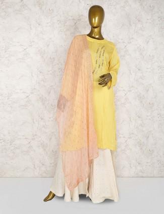 Yellow color cotton punjabi sharara suit
