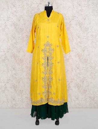 Yellow color lehenga cum suit in cotton silk