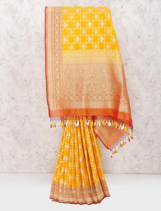 Yellow color lovely saree in banarasi semi silk