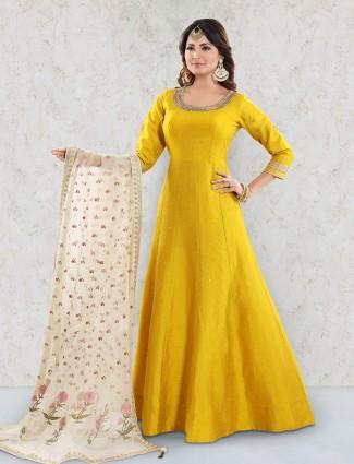 Yellow color raw silk anarkali salwar suit