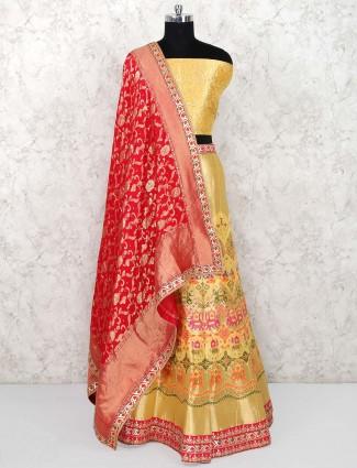 Yellow color semi stitched banarasi silk wedding lehenag choli