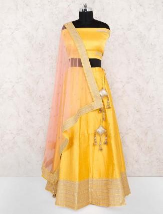 Yellow color silk fabric wedding lehenga choli