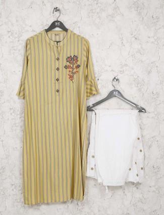 Yellow colored cotton fabric festive kurti set