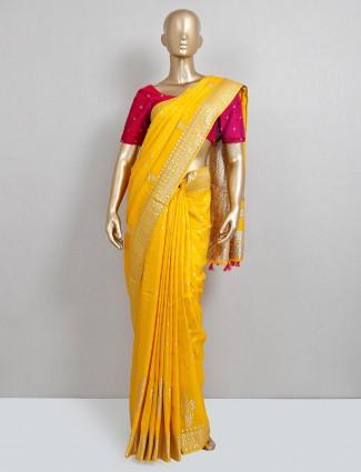 Yellow dola silk saree for wedding events