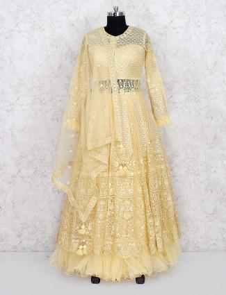Yellow hue net fabric designer lehenga cum salwar suit