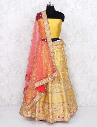 Yellow hue raw silk wedding semi stitched lehenga choli