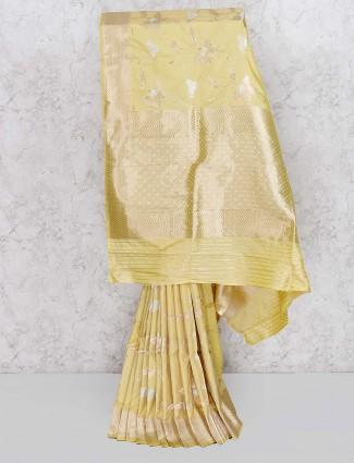 Yellow hue wedding saree in semi silk