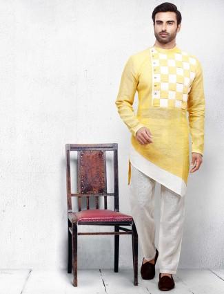 Yellow hued cotton fabric checks style kurta suit