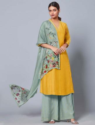 Yellow hued cotton silk fabric punjabi palazzo suit