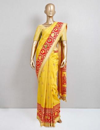 Yellow patola silk saree for festive days