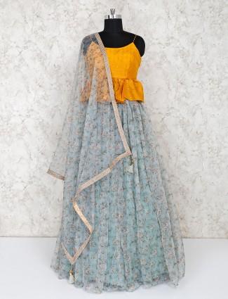 Yellow peplum style lehegnga choli in tissue silk
