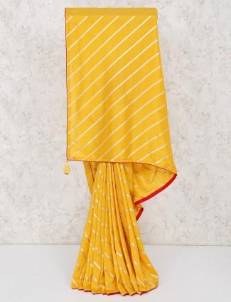 Yellow silk zari weaving in laheriya style saree