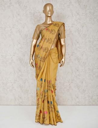 Yellow thread work cotton sari