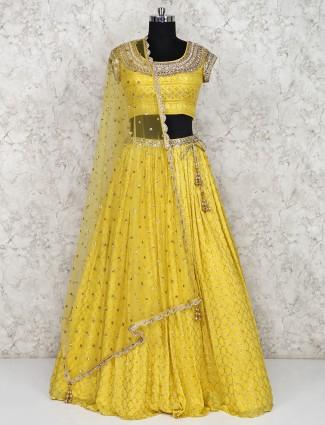 Yellow wedding lehenga choli in georgette